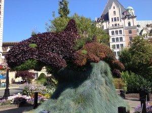 A whale made out of a bush.