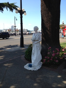 A woman being a statue, I'm surprised she didn't melt.