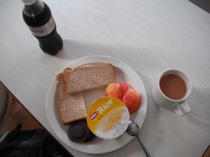 My lunch, a turkey and apple sandwich with the rest of the apple on the side, along with a rice pudding cup, two jaffa cookies and of course tea and diet coke lol