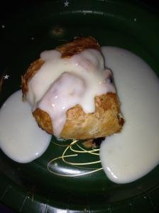 Hot apple strudel with vanilla sauce on top