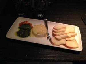 baked brie with basil pesto and red pepper jelly, served with crostini