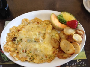 Veggie omelette with potatoes on the side.