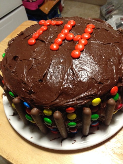Three layer cake decorated with M&M's and Cadbury's Chocolate Fingers